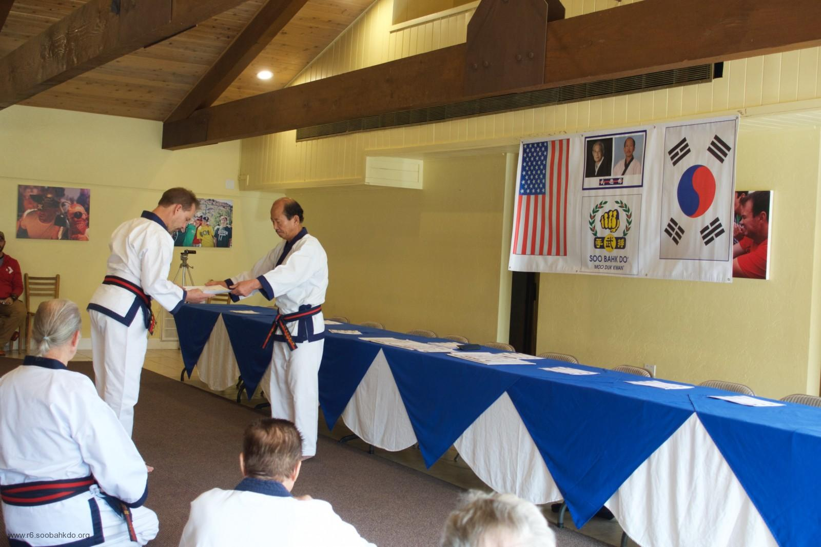 Kris Poole Receives Moo Duk Kwan 8th Dan Certificate